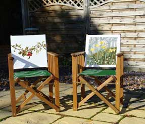 folding wooden chairs with botanical image printed on back panel