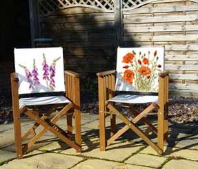 Folding tennis chairs with images of foxgloves and poppies printed from watercolour paintings onto the back panel